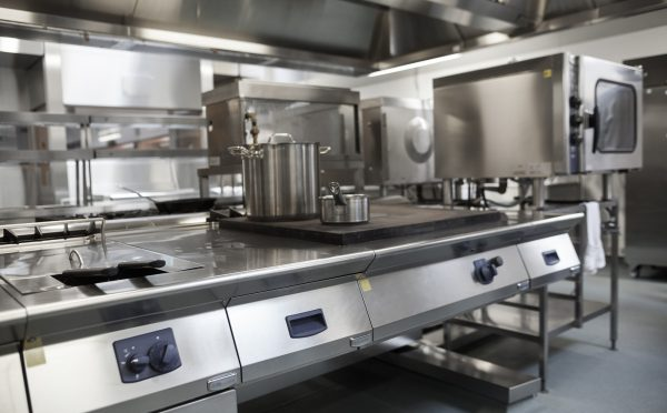 Picture Of Fully Equipped Professional Kitchen In Bright Light