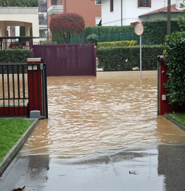 Entry Of A House During A Flood And Flooded Road